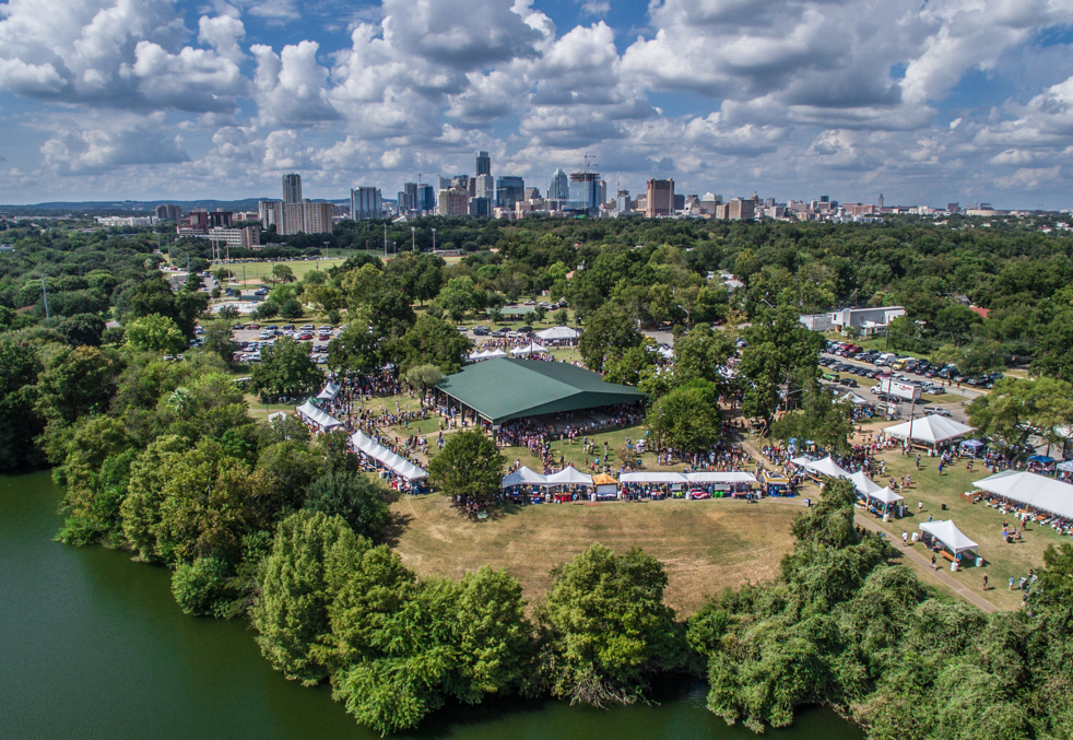 Aerial image of Texas Craft Brewers Festival tents at Fiesta Gardens on Ladybird Lake.